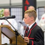 St Bede's College student at a lectern with microphone